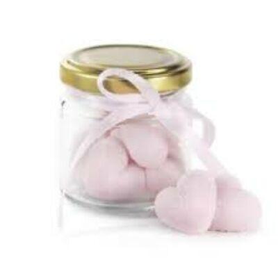 Üvegben rózsaszín szív alakú formacukor